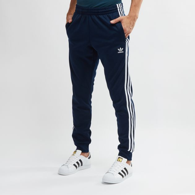 b22e88448ad6 Blue adidas Originals SST Track Pants