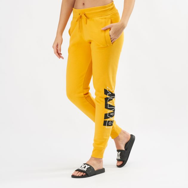 Shop Orange Ivy Park Layer Logo Slim Leg Jogger Pants