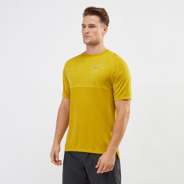fe4853a9 Shop Yellow Nike Dri-FIT Medalist Running T-Shirt   T-Shirts   Tops ...