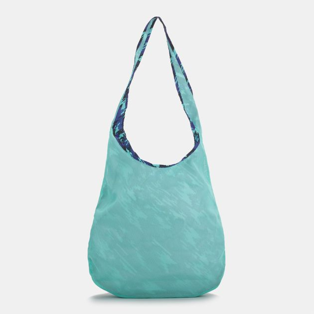 Shop Green Nike Graphic Reversible Tote Bag for Womens by Nike  2091a4c459753
